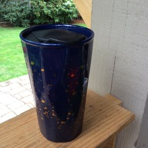 Aladdin tumbler mug navy with gold. Uneven surface
